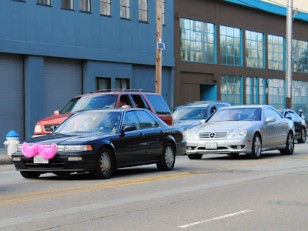 Community driver sporting Lyft's trademark pink 'carstache'. Photo courtesy of checkdoublecheck.blogspot.com